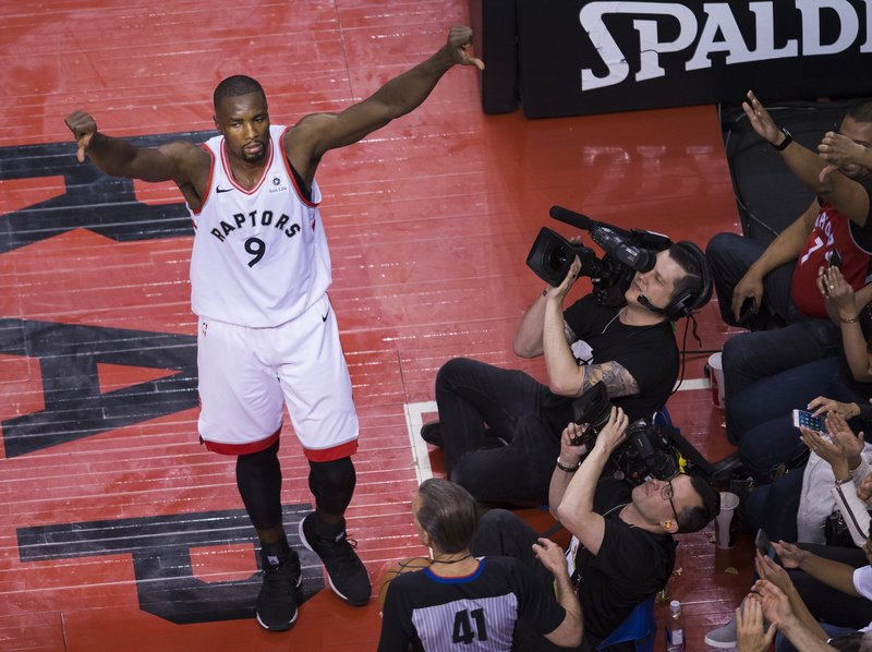 Toronto Raptors center Serge Ibaka (9) reacts after rejecting the ball against the Philadelphia 76ers during the second half of Game 1 of a second-round NBA basketball playoff series, in Toronto, Saturday, April 27, 2019. (Nathan Denette/The Canadian Press via AP)