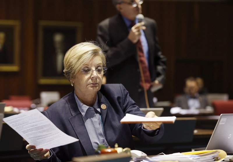 FILE - In this May 3, 2016 file photo Rep. Karen Fann, R-Prescott, goes over paperwork during budget deliberations at the Arizona Capitol in Phoenix. (AP Photo/Ross D. Franklin, File)