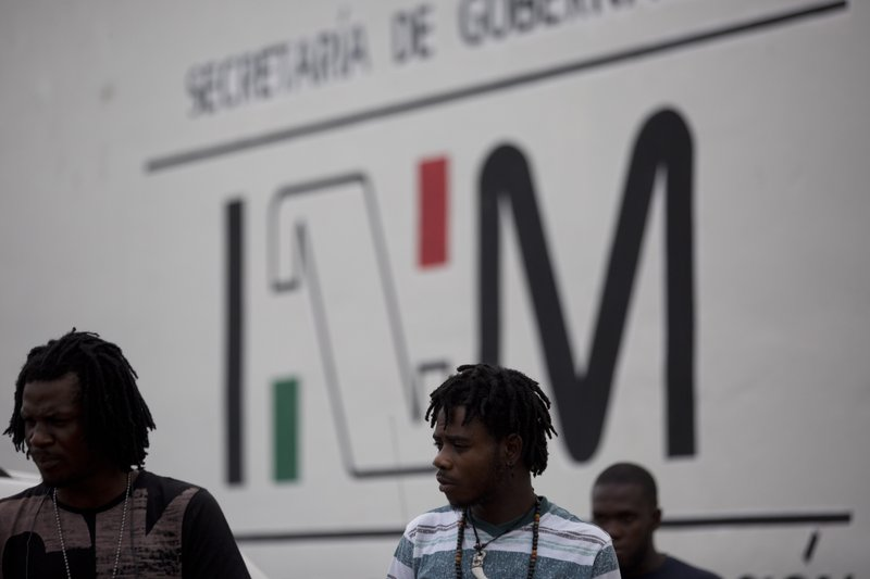 Migrants gather outside an immigration detention center to check on their legal status, in Tapachula, Chiapas state, Mexico, Friday, April 26, 2019. (AP Photo/Moises Castillo)
