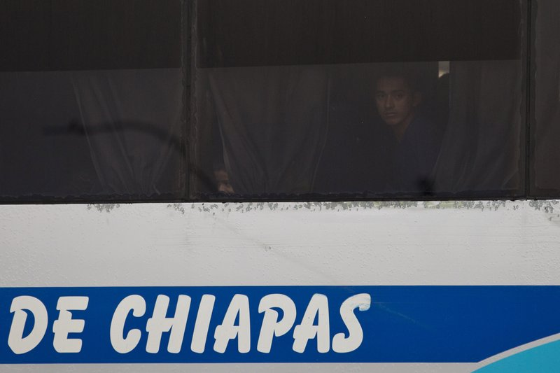 Migrants sitting on a bus are transferred for deportation from an immigration detention center in Tapachula, Chiapas state, Mexico, Saturday, April 27, 2019. (AP Photo/Moises Castillo)