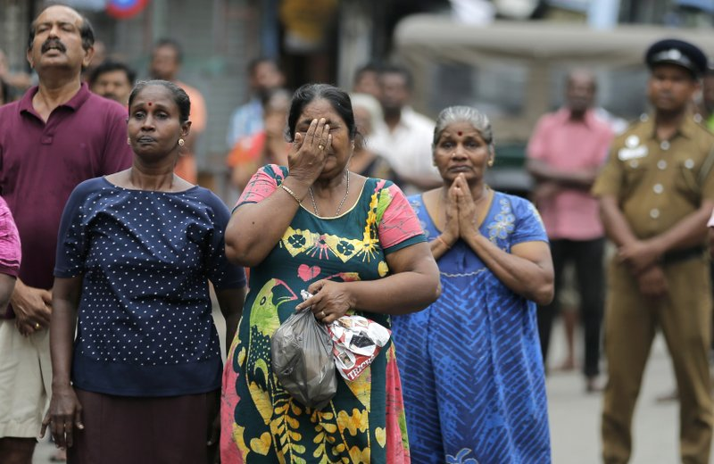 Sri Lankan Catholics pray standing on a road as they attend a brief holly service marking the seventh day of the Easter Sunday attacks near the exploded St. (AP Photo/Eranga Jayawardena)