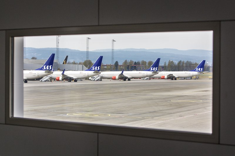 SAS planes are seen grounded at Oslo Gardermoen airport during pilots strikes, in Oslo, Friday, April 26, 2019. (Ole Berg-Rusten/NTB Scanpix via AP)