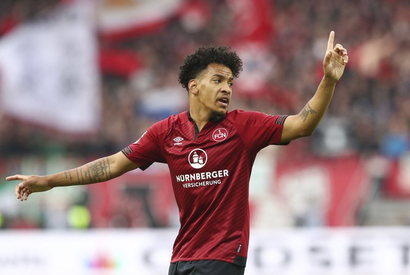 Nuremberg's Matheus Pereira gestures during the German Bundesliga soccer match between 1. FC Nuremberg and FC Bayern Munich in Nuremberg, Germany, Sunday, April 28, 2019. (AP Photo/Matthias Schrader)