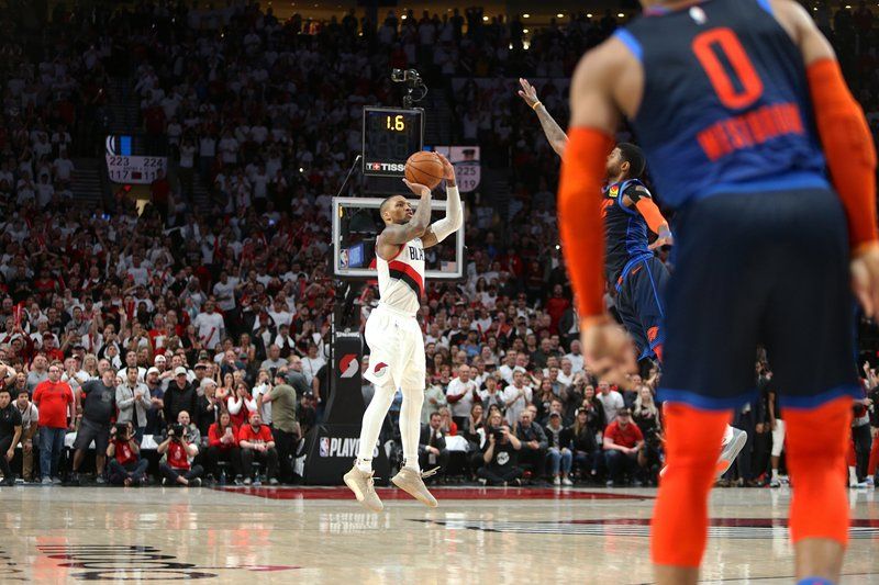 Portland Trail Blazers' Damian Lillard shoots the game-winning three-pointer to beat the Oklahoma City Thunder 118-115 in Game 5 of their best-of-seven first-round playoff series in Portland, Ore. (Sean Meagher/The Oregonian via AP)