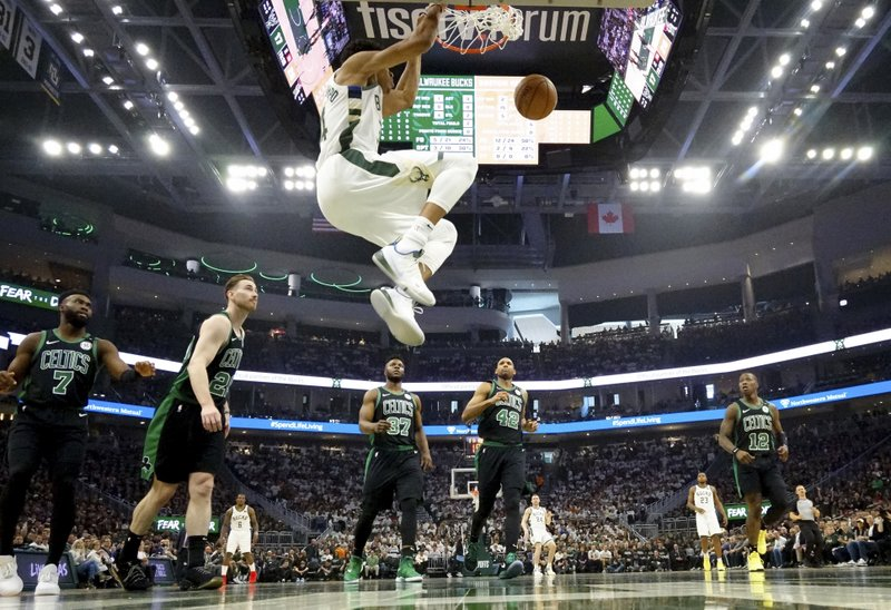 Milwaukee Bucks' Giannis Antetokounmpo dunks during the first half of Game 1 of a second round NBA basketball playoff series against the Boston Celtics Sunday, April 28, 2019, in Milwaukee. (AP Photo/Morry Gash
