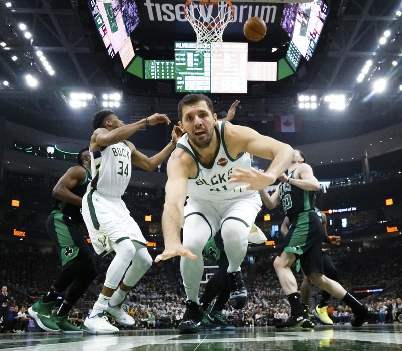 Milwaukee Bucks' Nikola Mirotic falls during the first half of Game 1 of a second round NBA basketball playoff series against the Boston Celtics Sunday, April 28, 2019, in Milwaukee. (AP Photo/Morry Gash)