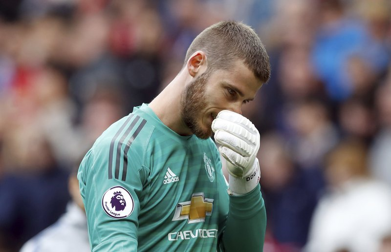 Manchester United goalkeeper David de Gea appears dejected after their English Premier League soccer match against Chelsea at Old Trafford, Manchester, England, Sunday, April 28, 2019. (Martin Rickett/PA via AP)