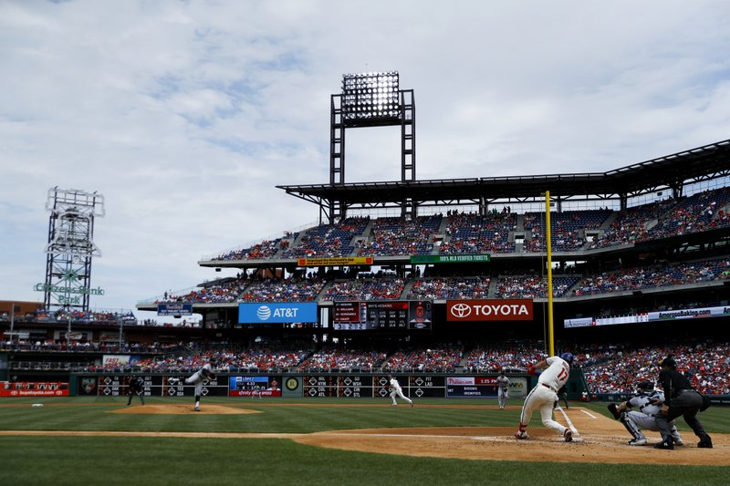 Philadelphia Phillies' Rhys Hoskins hits an RBI-double off Miami Marlins starting pitcher Pablo Lopez during the first inning of a baseball game, Sunday, April 28, 2019, in Philadelphia. (AP Photo/Matt Slocum)