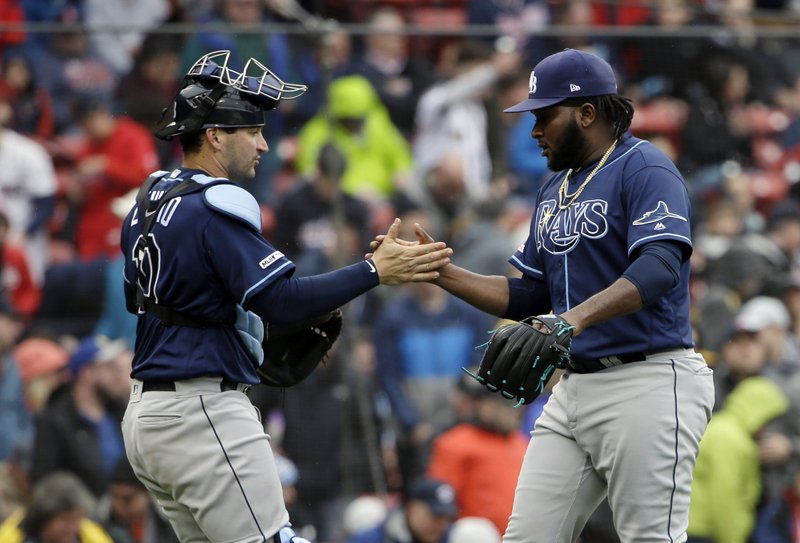 Tampa Bay Rays catcher Mike Zunino, left, celebrates with relief pitcher Diego Castillo, right, after defeating the Boston Red Sox in a baseball game at Fenway Park, Sunday, April 28, 2019, in Boston. (AP Photo/Steven Senne)