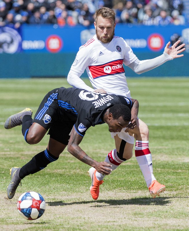 Chicago Fire's Aleksandar Katai, top, challenges Montreal Impact's Omar Brown during second-half MLS soccer match action in Montreal, Sunday, April 28, 2019. (Graham Hughes/The Canadian Press via AP)
