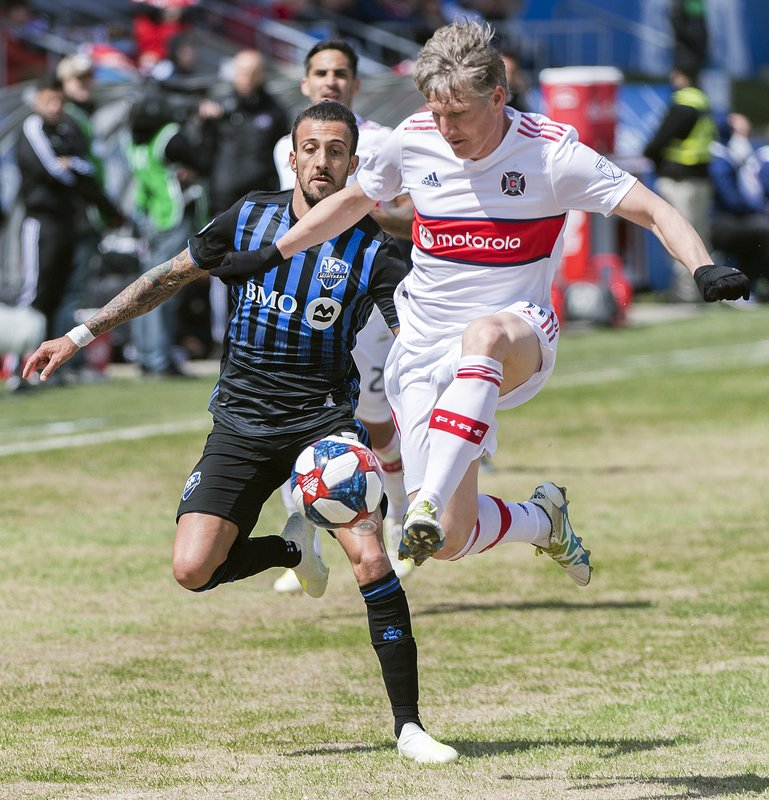 Chicago Fire's Bastian Schweinsteiger, right, defends the ball as Montreal Impact's Maximiliano Urruti moves in during second-half MLS soccer match action in Montreal, Sunday, April 28, 2019. (Graham Hughes/The Canadian Press via AP)