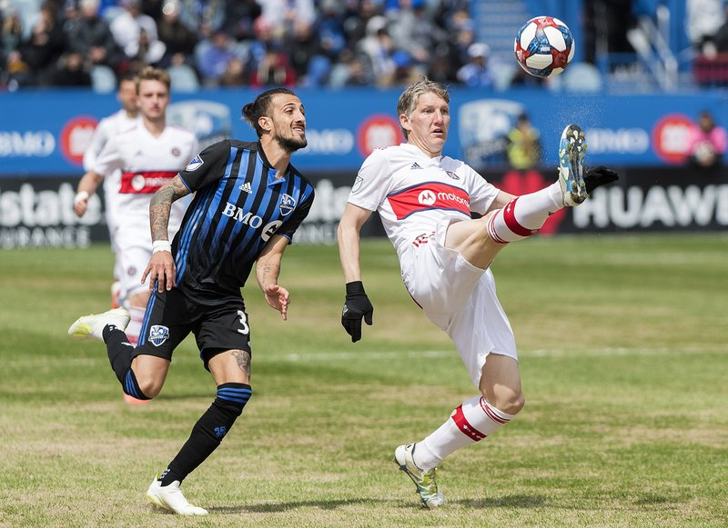 Chicago Fire's Bastian Schweinsteiger, right, defends the ball as Montreal Impact's Maximiliano Urruti moves in during second half MLS soccer action in Montreal, Sunday, April 28, 2019. (Graham Hughes/The Canadian Press via AP)