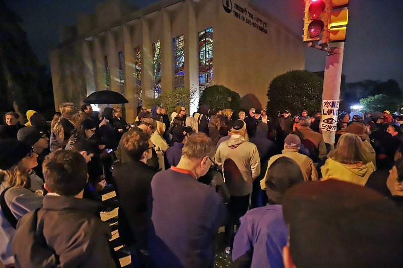 A group gathers outside the Tree of Life Synagogue for a vigil to honor the victims of the Saturday attack on a synagogue in California, Saturday, April 27, 2019, in the Squirrel Hill neighborhood of Pittsburgh. (AP Photo/Gene J. Puskar)