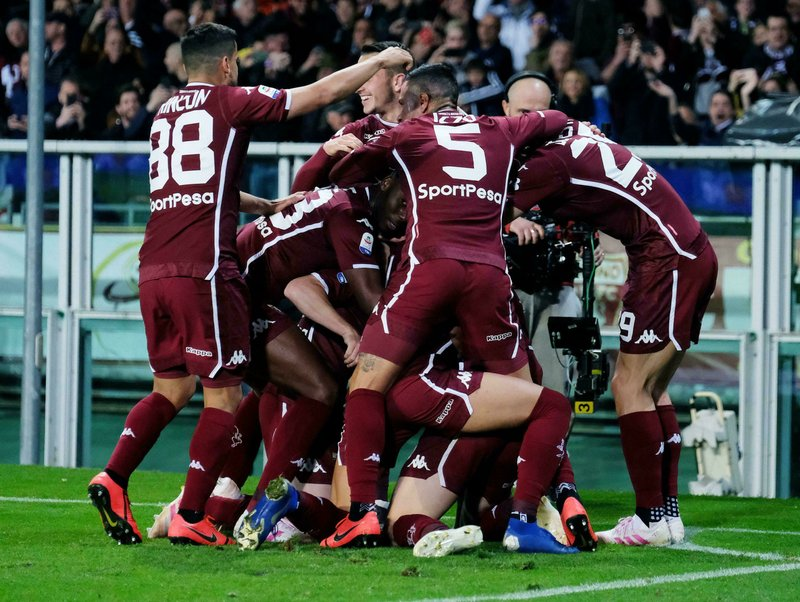 Torino's Andrea Belotti celebrates with teammates after scoring  during the Italian Serie A soccer match between Torino FC and AC Milan at the Olimpico Stadium in Turin, Italy, Sunday, April 28, 2019. (Alessandro Di Marco/ansa via AP)