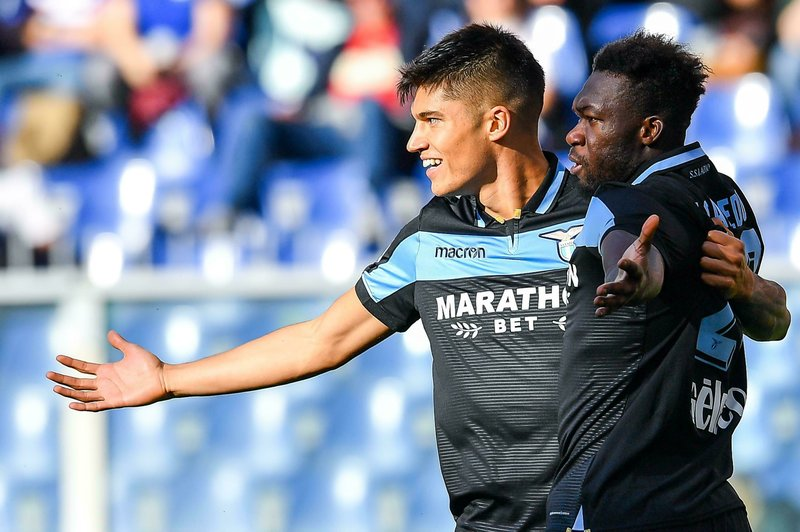 Lazio's Felipe Caicedo, right, celebrates with his teammate Joaquin Correa after he scored his side's opening goal during a Series A soccer match between Sampdoria and Lazio, at the Luigi Ferraris Stadium in Genoa, Italy, Sunday, Thursday, April 28, 2019. (Simone Arveda/ANSA via AP)