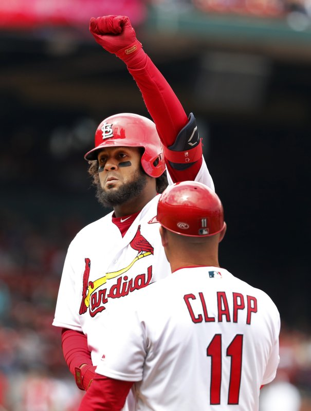 St. Louis Cardinals' Jose Martinez celebrates after hitting an RBI-single as first base coach Stubby Clapp (11) watches during the fourth inning of a baseball game against the Cincinnati Reds, Sunday, April 28, 2019, in St. (AP Photo/Jeff Roberson)