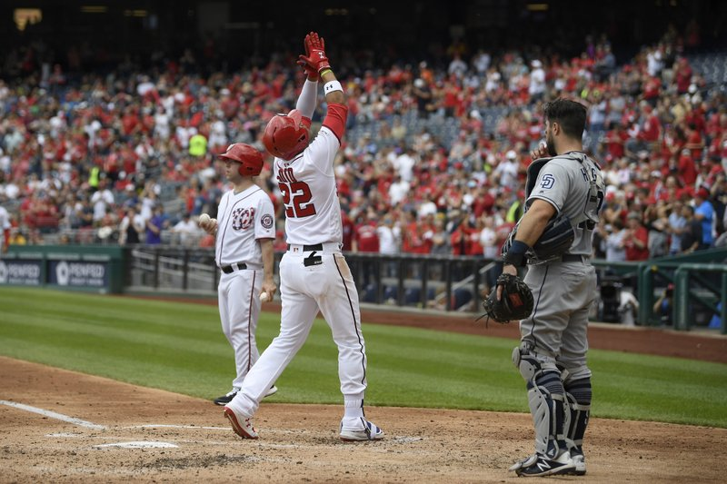 Washington Nationals' Juan Soto celebrates his three-run home run during the third inning of a baseball game as San Diego Padres catcher Austin Hedges, right, looks on, Sunday, April 28, 2019, in Washington. (AP Photo/Nick Wass)