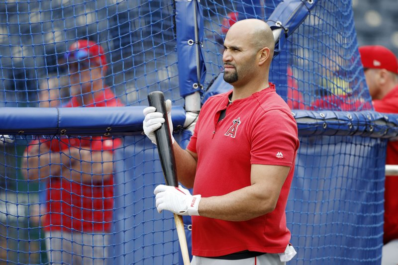 Los Angeles Angels' Albert Pujols looks toward the outfield during batting practice before a baseball game against the Kansas City Royals at Kauffman Stadium in Kansas City, Mo. (AP Photo/Colin E. Braley)