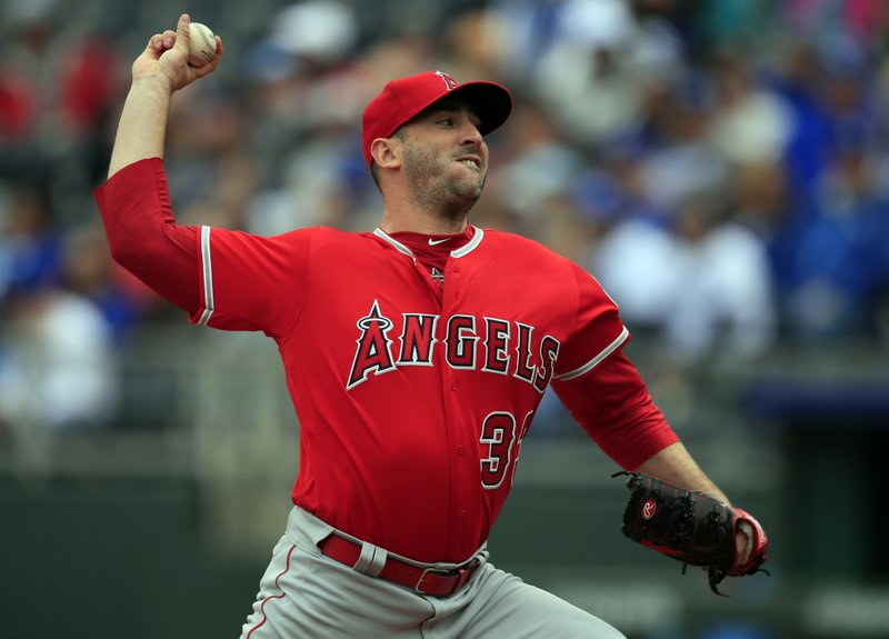 Los Angeles Angels starting pitcher Matt Harvey delivers to a Kansas City Royals batter during the first inning of a baseball game at Kauffman Stadium in Kansas City, Mo. (AP Photo/Orlin Wagner)