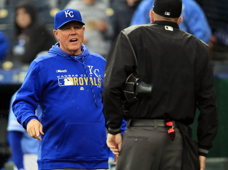 Kansas City Royals manager Ned Yost, left, calls for a play review during the ninth inning of a baseball game against the Los Angeles Angels at Kauffman Stadium in Kansas City, Mo. (AP Photo/Orlin Wagner)
