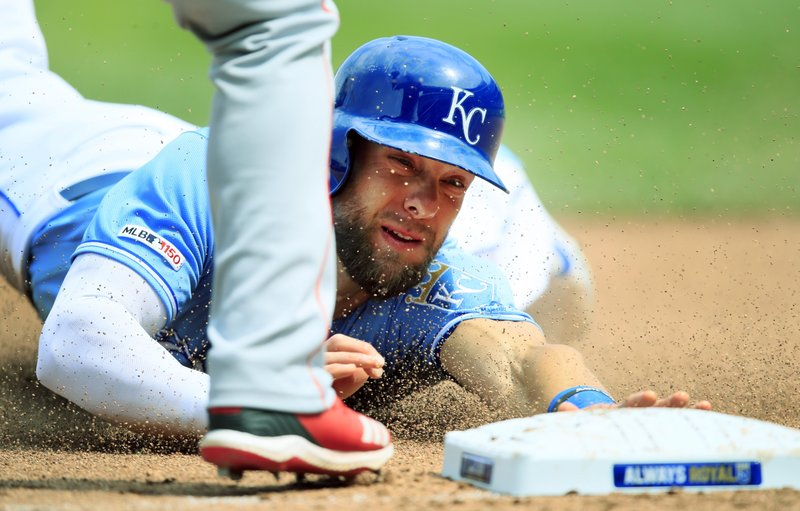 Kansas City Royals' Alex Gordon slides into third base during the fourth inning of a baseball game against the Los Angeles Angels at Kauffman Stadium in Kansas City, Mo. (AP Photo/Orlin Wagner)