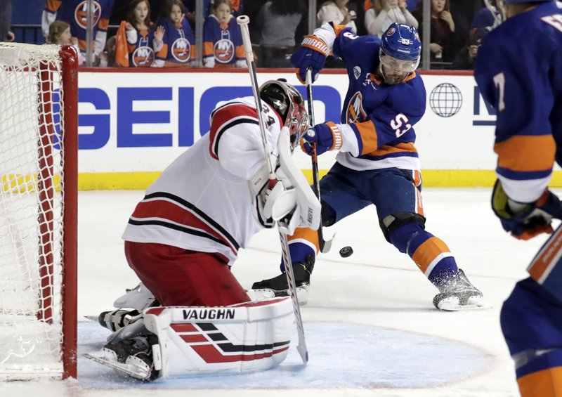 New York Islanders center Casey Cizikas (53) tries to shoot against Carolina Hurricanes goaltender Petr Mrazek, of the Czech Republic, during the second period of Game 2 of an NHL hockey second-round playoff series, Sunday, April 28, 2019, in New York. (AP Photo/Julio Cortez)