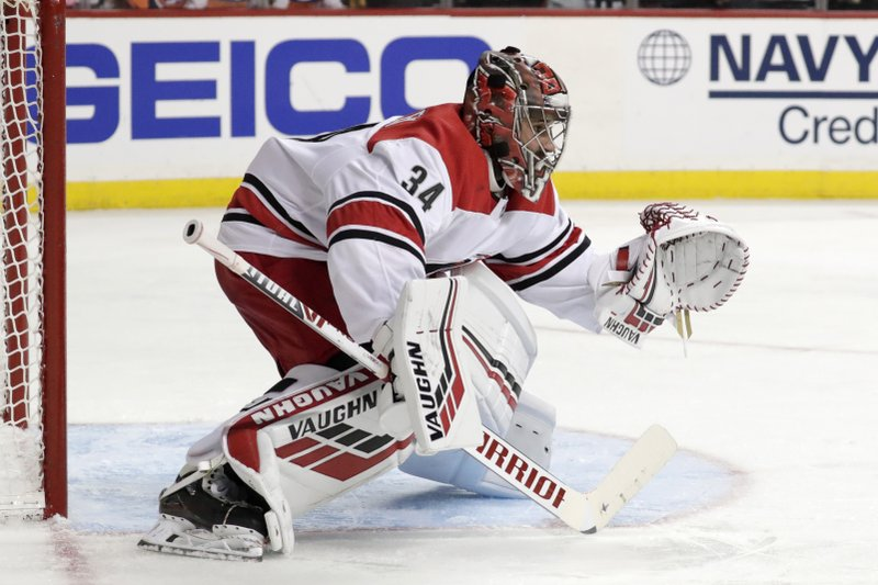 Carolina Hurricanes goaltender Petr Mrazek, of the Czech Republic, guards his net against the New York Islanders during the second period of Game 2 of an NHL hockey second-round playoff series, Sunday, April 28, 2019, in New York. (AP Photo/Julio Cortez)