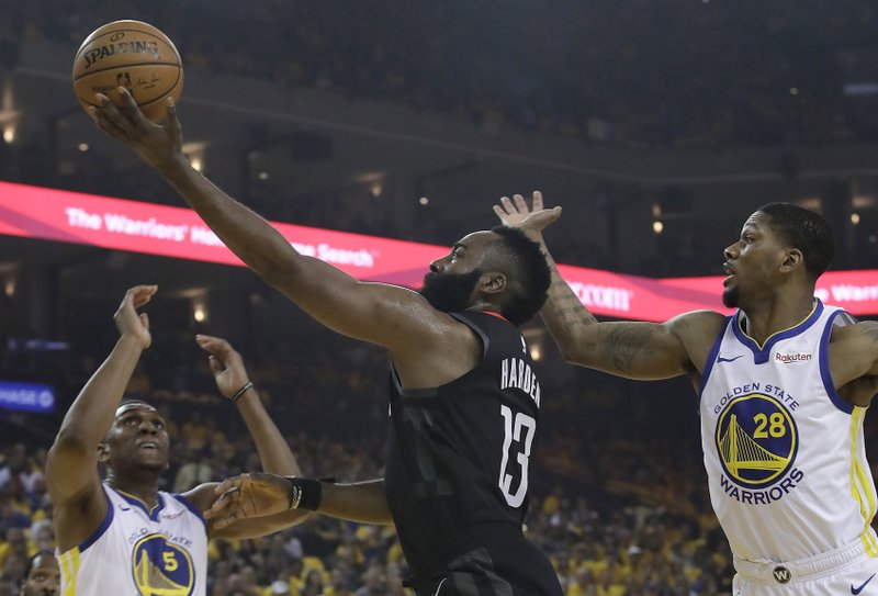 Houston Rockets guard James Harden (13) shoots between Golden State Warriors center Kevon Looney (5) and forward Alfonzo McKinnie (28) during the first half of Game 1 of a second-round NBA basketball playoff series in Oakland, Calif. (AP Photo/Jeff Chiu)