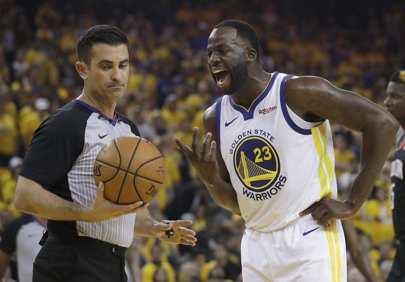 Golden State Warriors forward Draymond Green (23) argues with referee Zach Zarba during the first half of Game 1 of a second-round NBA basketball playoff series against the Houston Rockets in Oakland, Calif. (AP Photo/Jeff Chiu)