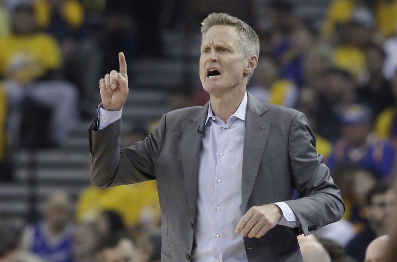 Golden State Warriors head coach Steve Kerr gesturs during the first half of Game 1 of a second-round NBA basketball playoff series against the Houston Rockets in Oakland, Calif., Sunday, April 28, 2019. (AP Photo/Jeff Chiu)
