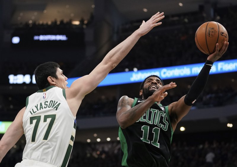 Boston Celtics' Kyrie Irving shoots past Milwaukee Bucks' Ersan Ilyasova during the second half of Game 1 of a second round NBA basketball playoff series Sunday, April 28, 2019, in Milwaukee. (AP Photo/Morry Gash)