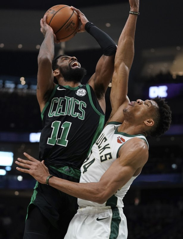 Boston Celtics' Kyrie Irving shoots over Milwaukee Bucks' Giannis Antetokounmpo during the second half of Game 1 of a second round NBA basketball playoff series Sunday, April 28, 2019, in Milwaukee. (AP Photo/Morry Gash)