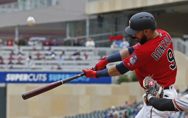 Minnesota Twins' Marwin Gonzalez hits a two-run single off Baltimore Orioles pitcher Dylan Bundy in the third inning of a baseball game Sunday, April 28, 2019, in Minneapolis. (AP Photo/Jim Mone)