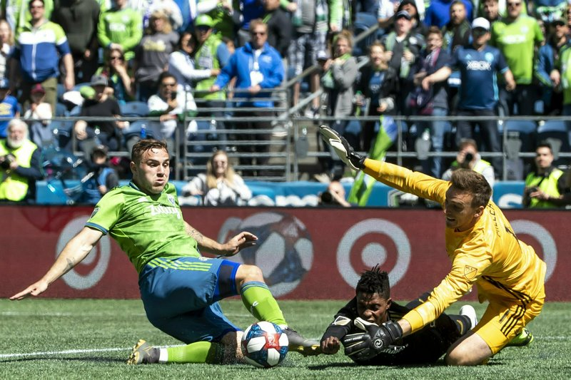 Seattle Sounders forward Jordan Morris tries to score against Los Angeles FC forward Latif Blessing and goalkeeper Tyler Miller in the second half of an MLS soccer game in Seattle, Sunday April 28, 2019. (Bettina Hansen/The Seattle Times via AP)
