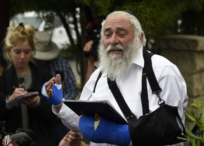 Rabbi Yisroel Goldstein speaks at a news conference at the Chabad of Poway synagogue, Sunday, April 28, 2019, in Poway, Calif. (AP Photo/Denis Poroy)