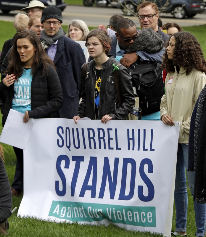 A group organized by Squirrel Hill Stands Against Gun Violence holds a rally in Squirrel Hill, Sunday, April 28, 2019. (AP Photo/Gene J. Puskar)