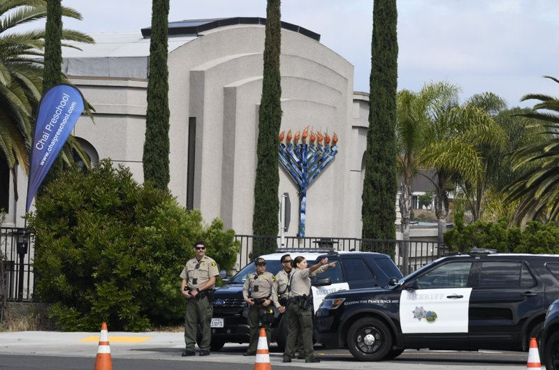 San Diego county sheriff deputies stand in front of the Chabad of Poway synagogue, Sunday, April 28, 2019, in Poway, Calif. (AP Photo/Denis Poroy)