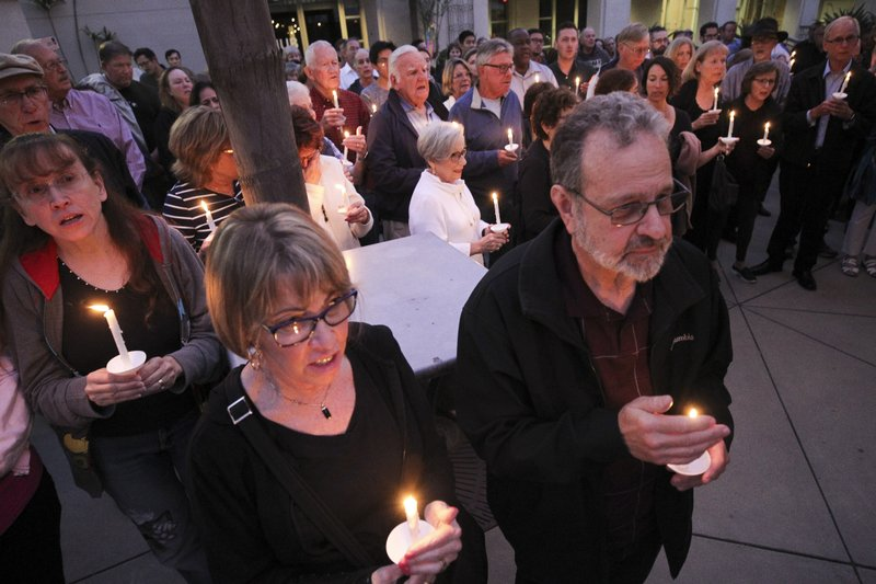 People from the community, many of them of various faiths, join members of the Rancho Bernardo Community Presbyterian Church in a candlelight vigil for the Chabad of Poway synagogue shooting victims at the Rancho Bernardo Community Presbyterian Church in the Rancho Bernardo neighborhood of San Diego, Calif. (Hayne Palmour IV/The San Diego Union-Tribune via AP)