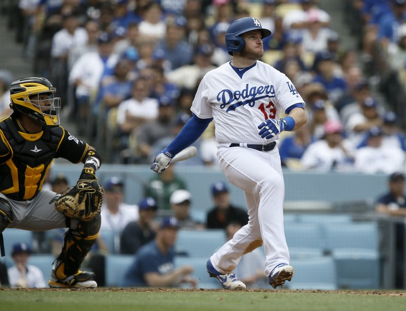 CORRECTS TO FIFTH INNING NOT FOURTH Los Angeles Dodgers' Max Muncy, right, hits an RBI single with Pittsburgh Pirates catcher Elias Diaz watching during the fifth inning of a baseball game in Los Angeles, Sunday, April 28, 2019. (AP Photo/Alex Gallardo)