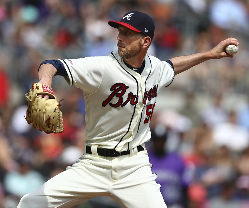 Atlanta Braves newly acquired left-handed pitcher Jerry Blevins delivers against the Colorado Rockies during the seventh inning of a baseball game Sunday, April 28, 2019, in Atlanta. (Curtis Compton/Atlanta Journal-Constitution via AP)