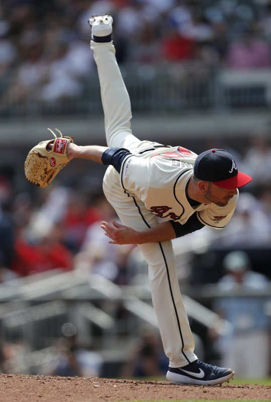 Atlanta Braves relief pitcher Jerry Blevins works in the seventh inning of a baseball game against the Colorado Rockies, Sunday, April 28, 2019, in Atlanta. (AP Photo/John Bazemore)
