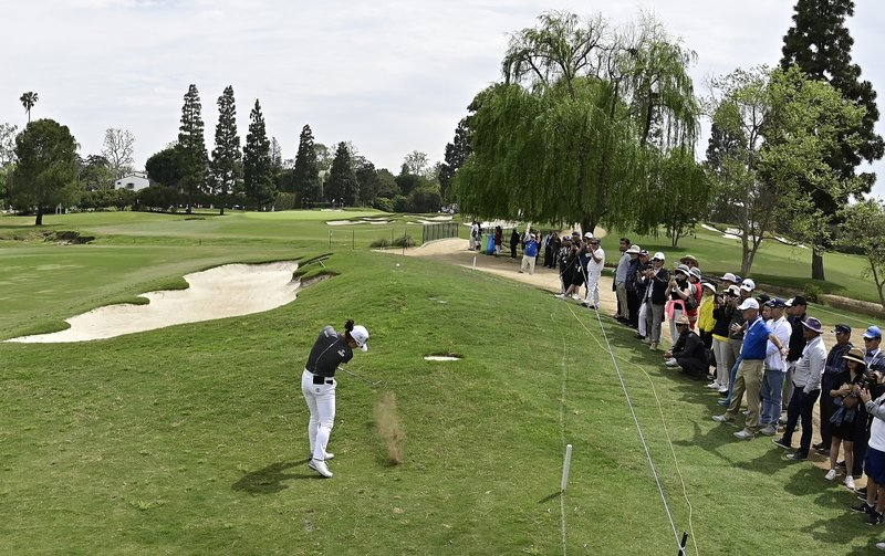 Minjee Lee, of Australia, makes her approach shot on the fifth hole during the final round of the Hugel-Air Premia LA Open golf tournament at Wilshire Country Club, Sunday, April 28, 2019, in Los Angeles. (AP Photo/Mark J. Terrill)