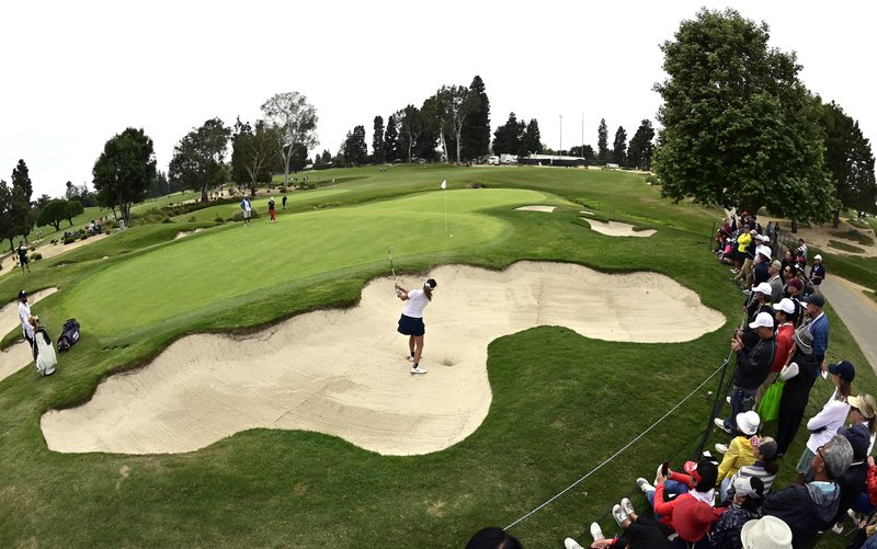 Annie Park hits out of a bunker on the fourth hole during the final round of the Hugel-Air Premia LA Open golf tournament at Wilshire Country Club Sunday, April 28, 2019, in Los Angeles. (AP Photo/Mark J. Terrill)