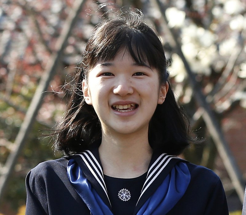FILE - In this March 22, 2017, file photo, Japan's Princess Aiko poses for photos as she attend her graduation ceremony at the Gakushuin Girls' Junior High School in Tokyo. (Issei Kato/Pool Photo via AP)