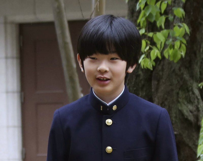 FILE - In this April 8, 2019, file photo, Prince Hisahito poses for photos at Ochanomizu University Junior High School before attending the entrance ceremony in Tokyo. (AP Photo/Koji Sasahara, Pool, File)