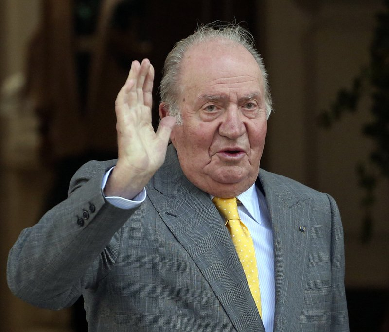 FILE -  In this March 10, 2018, file photo, Spain's emeritus King Juan Carlos waves upon his arrival to the Academia Diplomatica de Chile, in Santiago where he met with President-elect Sebastian Pinera. (AP Photo/Esteban Felix, File)