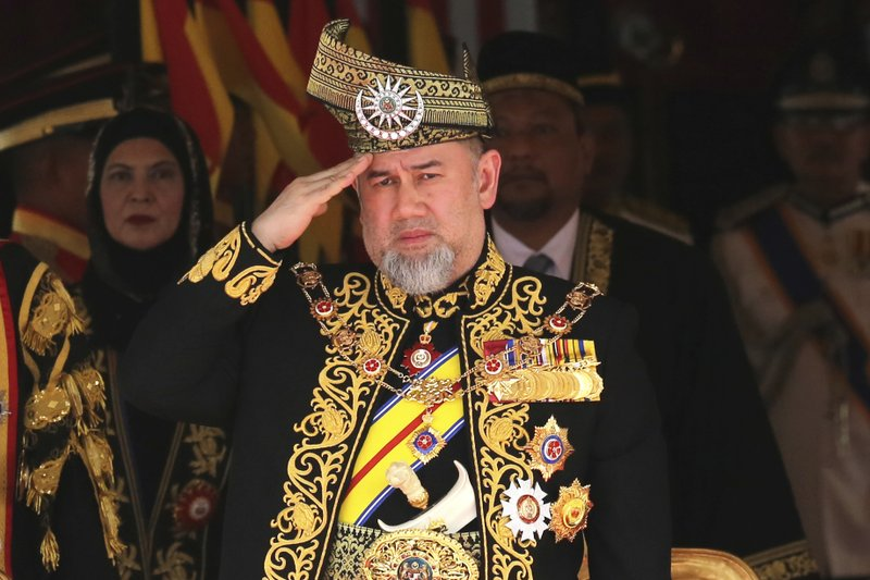 FILE - In this July 17, 2018, file photo, Malaysian then King Sultan Muhammad V salutes during the national anthem at the opening of the 14th parliament session at the Parliament house in Kuala Lumpur, Malaysia. (AP Photo/Yam G-Jun, File)