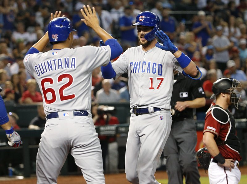 Chicago Cubs' Kris Bryant (17) is congratulated by teammate Jose Quintana after hitting a two-run home run against the Arizona Diamondbacks during the third inning of a baseball game, Sunday, April 28, 2019, in Phoenix. (AP Photo/Ralph Freso)