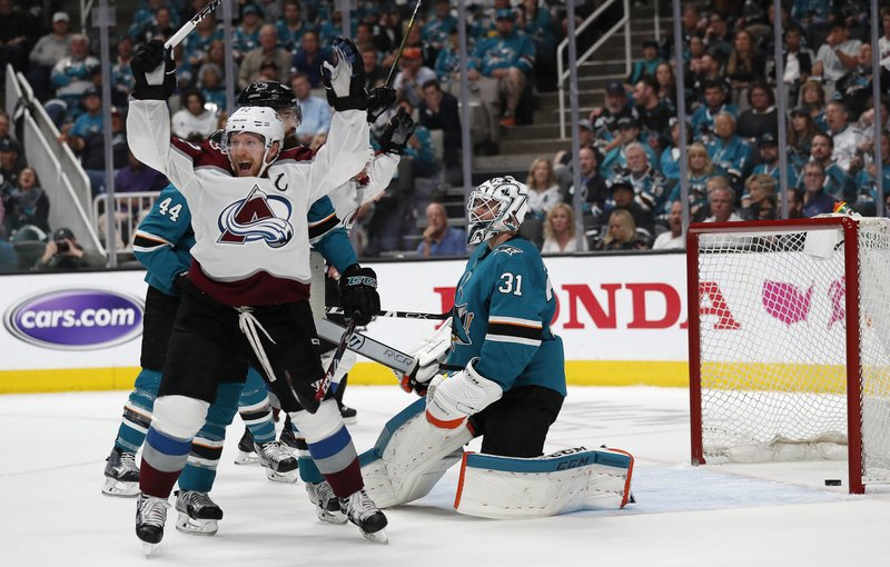 Colorado Avalanche's Gabriel Landeskog (92) celebrates a goal against San Jose Sharks goaltender Martin Jones (31) by teammate Tyson Barrie (not shown) in the second period of Game 2 of an NHL hockey second-round playoff series at the SAP Center in San Jose, Calif., on Sunday, April 28, 2019. (AP Photo/Josie Lepe)