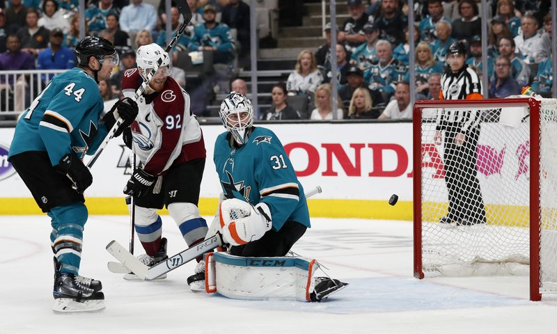 San Jose Sharks' Marc-Edouard Vlasic (44) watches as Colorado Avalanche's Gabriel Landeskog (92) scores goal against Sharks goaltender Martin Jones (31) in the second period of Game 2 of an NHL hockey second-round playoff series at the SAP Center in San Jose, Calif. (AP Photo/Josie Lepe)